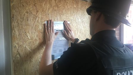 A/Sgt Sam Burton at work placing a closure order at a flat on Watson Grove, in Norwich. Picture: Dom