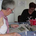 Volunteers at the Fakenham Talking Times organise articles to be recorded PICTURE: Fakenham Talking