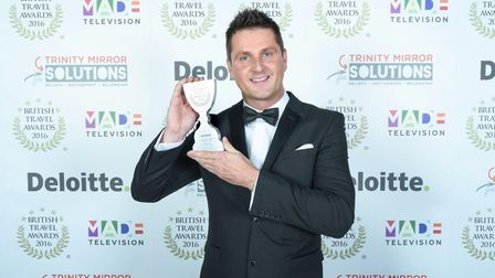 Simon Altham, collects the Best Large Special Interest Holiday Company award at the British Travel A