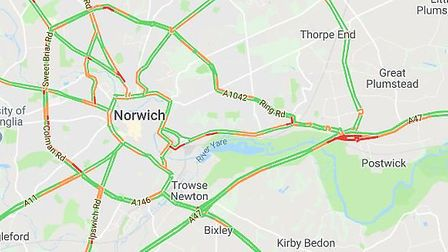 Drivers are facing delays after a collision involving two vehicles blocked a major road near Norwich
