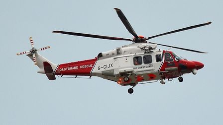 A coastguard helicopter extracted a man with suspected nerve damage from a north Norfolk beach. Pict