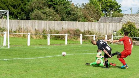Swaffham's Joe Jackson unlucky with a one on one, his effort hitting the post. Picture: Eddie Deane