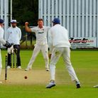 Celebration time for Norfolk as Ryan Findlay takes a wicket against Buckinghamshire. The umpire is f