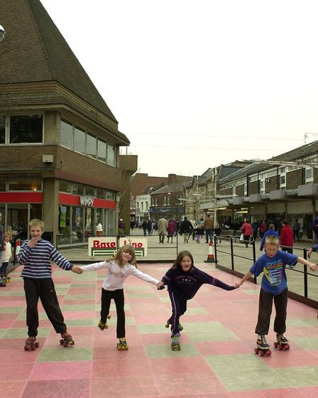 Youngsters enjoying the temporary roller skating surface set up as an additional attraction in New