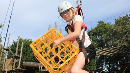 Nine-year-old Freya Merryweather has a go at a crate stacking challenge at Hilltop Outdoor Centre's