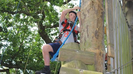 Twelve-year-old Zach Dunne tries out the high ropes at Hilltop Outdoor Centre's 30th birthday celebr