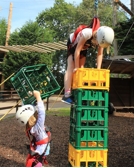 Nine-year-old Freya Merryweather and sister Ava, 6, have a go at a crate stacking challenge at Hillt