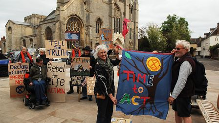 Scenes from a climate change protest by Extinction Revolution acivists before West Norfolk council's