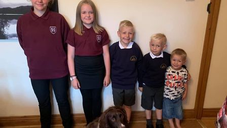 Lindsey Kenny got her children (and the dog) involved in this 'first day of school' picture. Picture