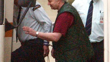 Farmer Tony Martin is escorted to a prison van as he leaves the High Court in central London in 2001