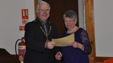 Sue Doy collects her certificate from Barrie Remblance during the Southwold and Reydon Society Award