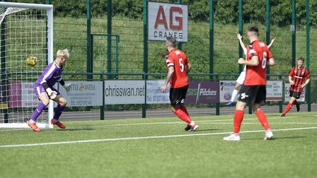The Redditch keeper is unable to stop the own goal from his captain Jordan Stoddart Picture: Shirley