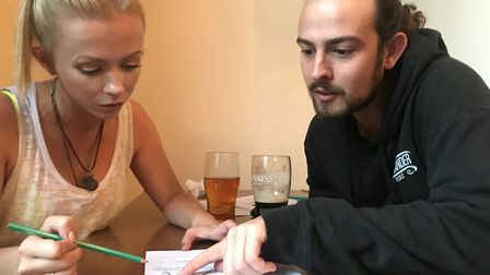 Sophie Allinson and Jack Sutton from Norwich tackle one of the brainteasers at the Puzzled Pint even
