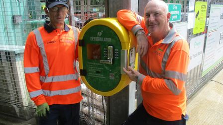 Staff at the Heacham recycling centre with the on-site lifesaving defibrillator. Picture: Norfolk Co