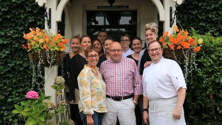 Deborah and Pat Palmer with staff outside The Hare Arms. Picture: Sarah Hussain