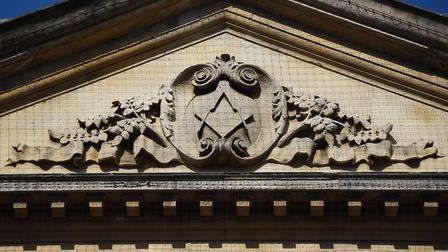 The square and compass emblem above the Provincial Freemason Grand Lodge of Norfolk in St Giles Stre