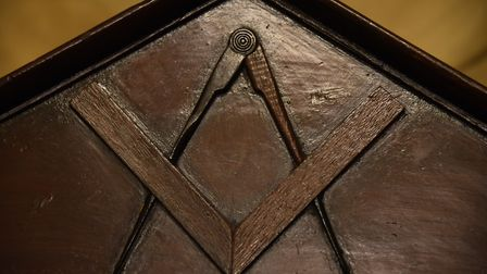 The square and compass, the universal emblem of the Freemasons, on a chair at the Provincial Freemas