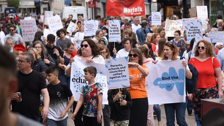 Protesters march against government 'under-funding' of education for children with special needs. Pi