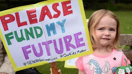 Lily Millins, three, with her sign for the march against government 'under-funding' of education for