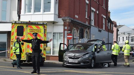 A PCSO diverts traffic at the scene of the collision on Battery Green Road. Photo: Matthew Nixon
