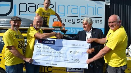 The Rumble in the Bumble team handing over a cheque to Roger Bassham of Prostate Cancer UK. PHOTO: P