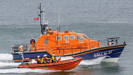A man who was cold and shaking badly was rescued by lifeboat crews after he went missing on his morn