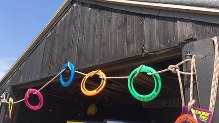 Flying plastic rings make colourful bunting at a campaign launch but are lethal to seals if they fin