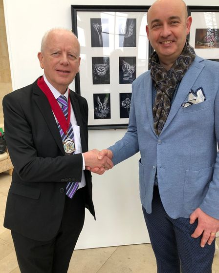 Michael I'Anson receiving his Silver award from the president of the Royal Photographic Society PICT