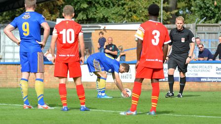 Adam Marriott places the ball on the penalty spot during Kings Lynn Town's draw with Gloucester City