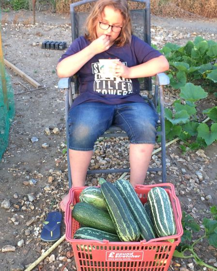 Wayne List and his son Teddy (pictured) had their vegetables grown for charity stolen from outside t