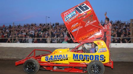 The packed terraces gave Norfolk''s Mat Newson a hero's welcome when he entered the track Picture: C