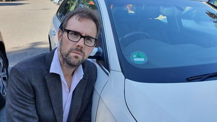 Liberal Democrat group leader James Wright displaying a European emissions sticker on a car. Picture