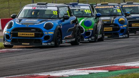 Dan Zelos, in car 445, putting pressure on Mini JCW Challenge race leader Rory Cuff before the Dereh