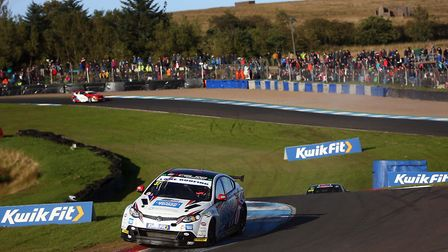 Draper Tools-supported Rob Smith attacking the kerbs at Knockhill in his MG6 Picture Jakob Ebrey Pho