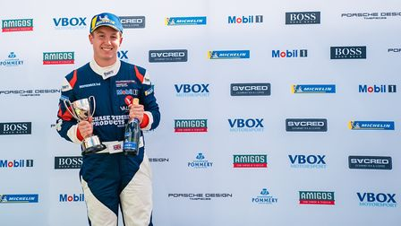 A delighted Adam Hatfield standing on the podium at Silverstone having claimed third place in the Pr