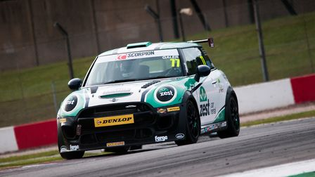 Lewis Galer at speed in the second of the Mini JCW Challenge races which ended with the Litcham race