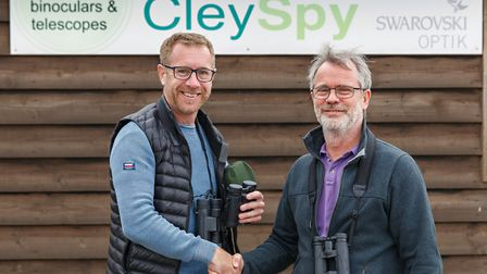 Tim Strivens, director at Cley Spy, Glandford, donating bonoculars and telescopes for the 'Power the