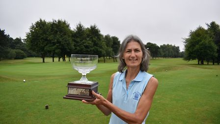 Karen Young, pictured after winning the East Region Seniors' Championship at Colne Valley, had an ex