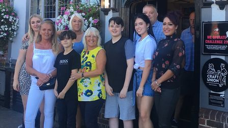 Family and friends of Kerri McAuley celebrating Kerri's Day, including sons Blake (front row in Boss