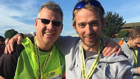 Dominic Blake with Jonathan Thetford at the finish of the Round Norfolk Relay. Picture: Reepham Runn