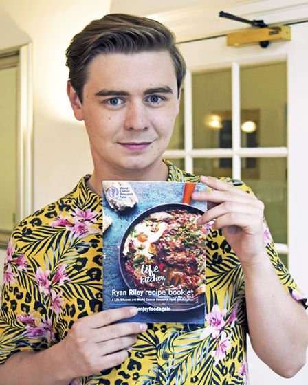 Ryan Riley with the recipe book he has written for World Cancer Research Fund (C) World Cancer Resea