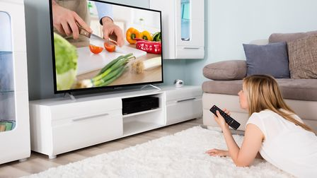The average Briton spends more than five hours a week watching other people cook on TV and just four