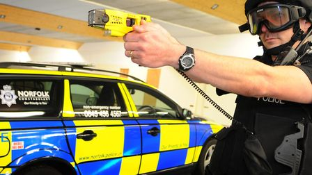 A Police officer armed with a TASER.