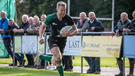 Jim Riley speeds down the wing for another try for North Walsham Picture: HYWEL JONES