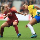 England's Beth Mead (left) and Brazil's Feitoza Kathellen during the International Friendly match at