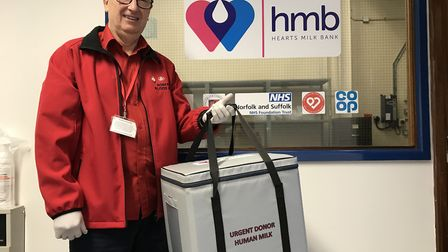 Keith Grisedale from Norfolk Blood Bikes with a breast milk donation. Picture: Ella Wilkinson