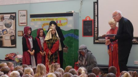 The 'Open the Book' Team from Yare Valley Churches had children at Brundall Primary School in costum