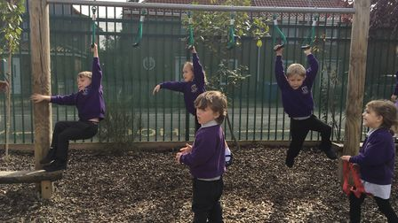 Mile Cross Primary School's new Reception children aren't hanging around with learning new skills in