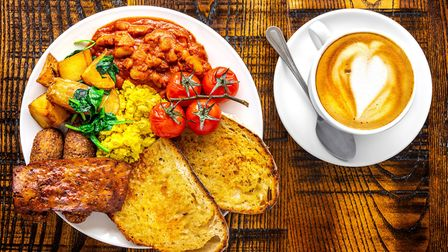 Vegan fry up with toast, beans, tomato, potatoes and bacon from The Tipsy Vegan, served with coffee