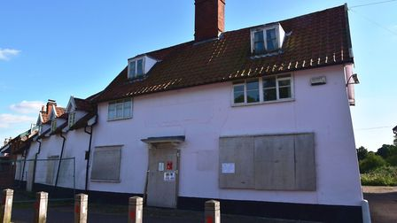 The boarded up former Kings Head, which has been closed since 2007, stands at the centre of Pulham S